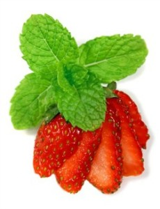 Fresh sliced strawberries with mint.